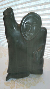 Inuit soapstone: Standing Hunter, Right Arm Raised