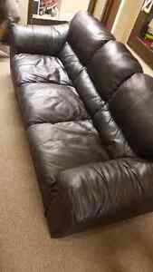Black Leather Couch need to sell quick will deliver to house
