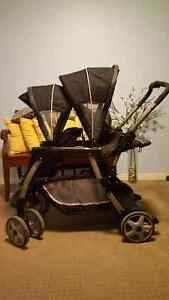 Sit and stand double stroller w/ infant carrier