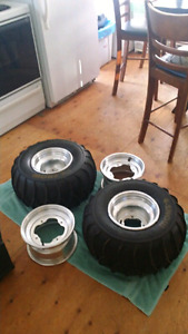 "4 snows and yamaha 9"" atv rims all new make an offer"