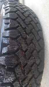**LIKE NEW   i have two   195 75 14 tires