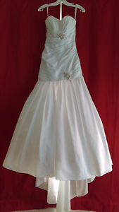 Superbe robe de mariée jamais porté de taille 4