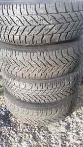 Good year ultra winter grip tires on rims 235 65 17