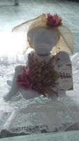 Ceramic cherub with tag, in like new condition [no chips] $10