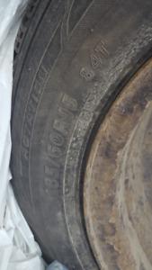 4 studded winter tires on rims plus Toyota Hub caps