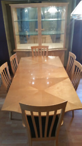 Large wooden dining table with cabinet
