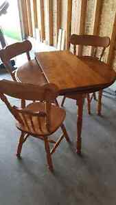 Solid Oak table with 3 chairs and insert Kitchener / Waterloo Kitchener Area image 1