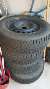 Set of 4 snow tires and rims for Dodge Caravan