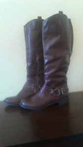 Women's brown leather riding boots.