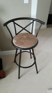 Two swivel bar stools with padded seat