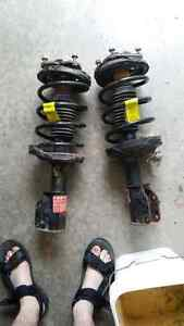 Front Strut assembly for mazda cars 200 obo or trade