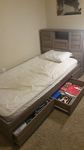 SINGLE BED WITH MATTRESS AND A LOT OF STORAGE