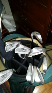 Used set of golf clubs with bag.