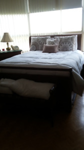 Queen size sleigh bed with box spring and mattress;