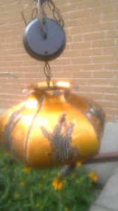 Hand crafted brass coloured tin hanging light with fixture.