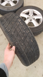 Barely used all season tires on rims 15 inch