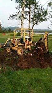 FOR RENT: Terramite TC5 mini backhoe.