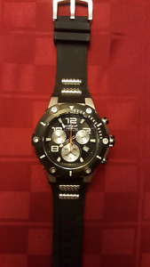 New in case men's Invicta Speedway black dial watch.
