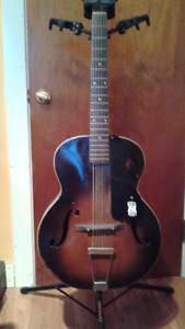 Vintage Monterey guitar with some refurb; perfect for slide