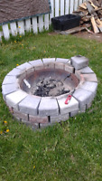NEED A STONE FIRE PIT OR FLOWER GARDEN?