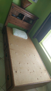 Wooden bed frame with drawers and head board