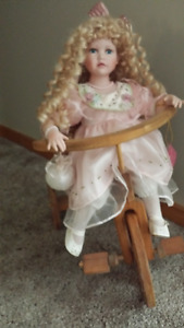 """24"""" Porcelain Doll on Wooden Tri-Cycle"""