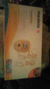 Never used brand new medella freestyle double breast pump