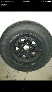 4x15 inch steel rims from a Buick lasabre 2002