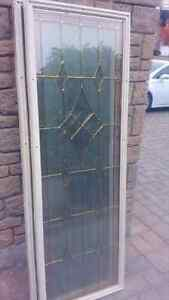 Front entry door glass inserts