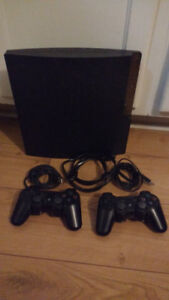 Play Station 3 + 2 controllers + motion controller + games