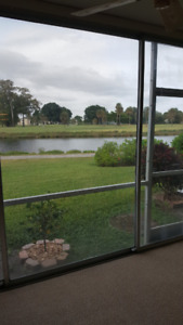 FIRST FLOOR CORNER UNIT ON WATER WITH VIEW OF GOLF COURSE