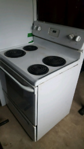 2 fridges and a stove all electric