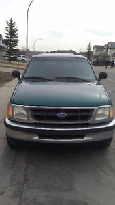 1997 Ford 150 XL Pickup Truck with canopy