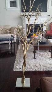 2  golden rubber trees decorated with crystals