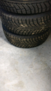 ALMOST BRAND NEW 245/65/17 WINTER TIRES  AMD RIMS WITH SENSORS