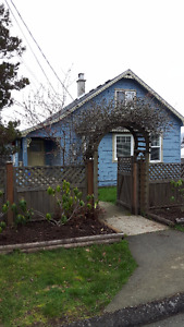 Character home with fully fenced yard and convenient location