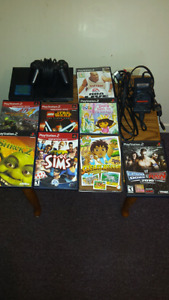 PS2 w/ controller, Memory card & 8 games