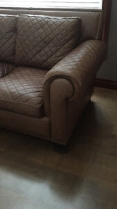 2 brown quilted leather couches