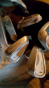 2 sets of golf clubs right handed