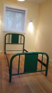 Green metal twin bed frame