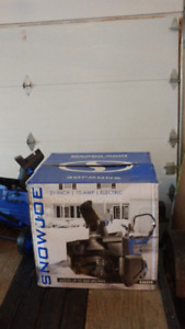 Snow thrower, 21-inch, 15 amp, electric. Price - $220