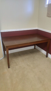 Large wooden table with 4 chairs