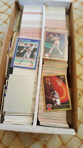 Lots of old collectable hockey, football and baseball cards.