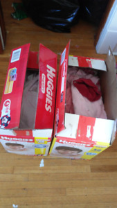 Two boxes of baby girl clothing mostly 6-12 months