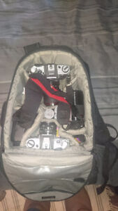 Canon AE1 cameras, lenses and pack
