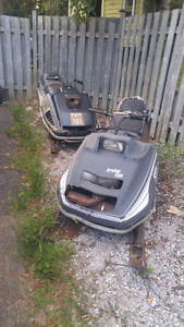 Two old snowmobiles