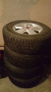 Winter tires on some nice rims. P235/70/R16. Asking $850. Neg.