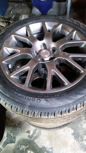 """BUICK 18"""" RIMS AND TIRES $1000"""