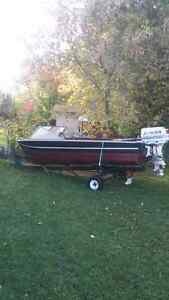 40 hp aluminum 14 foot fiahing boat with trailer.