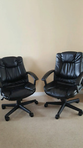 2 black leather computer chairs